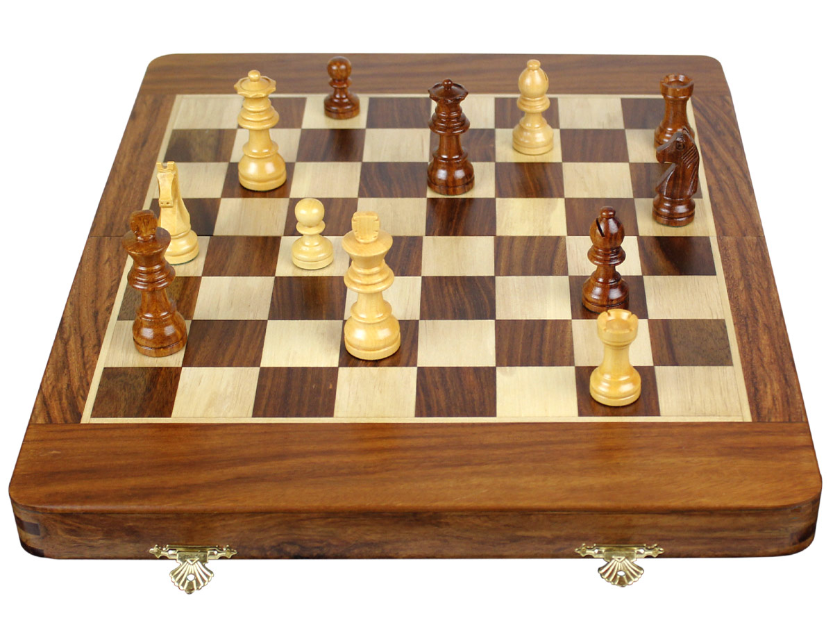 Front view of fully open chess board with pieces