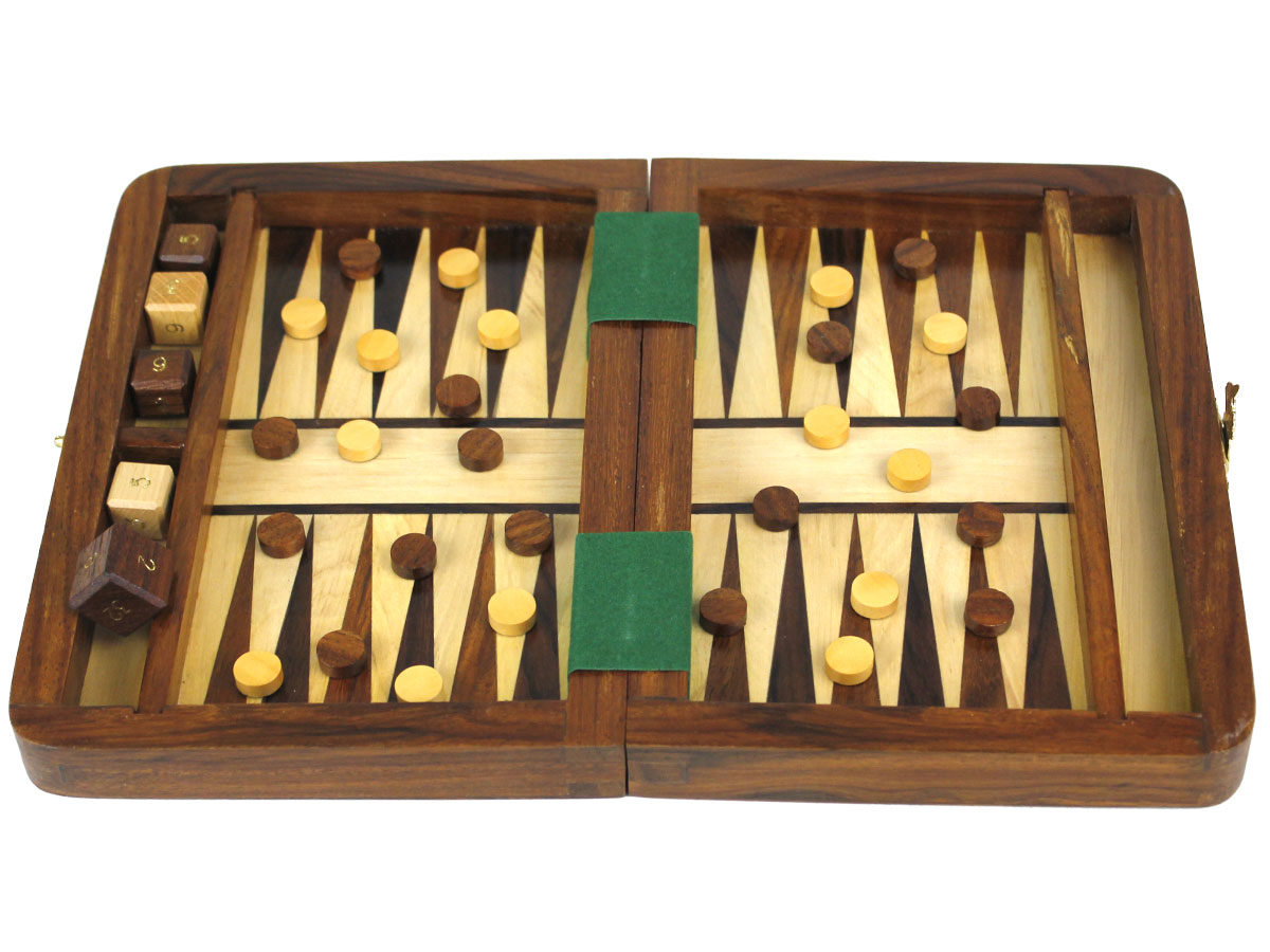 Fully open backgammon board with checkers and dice