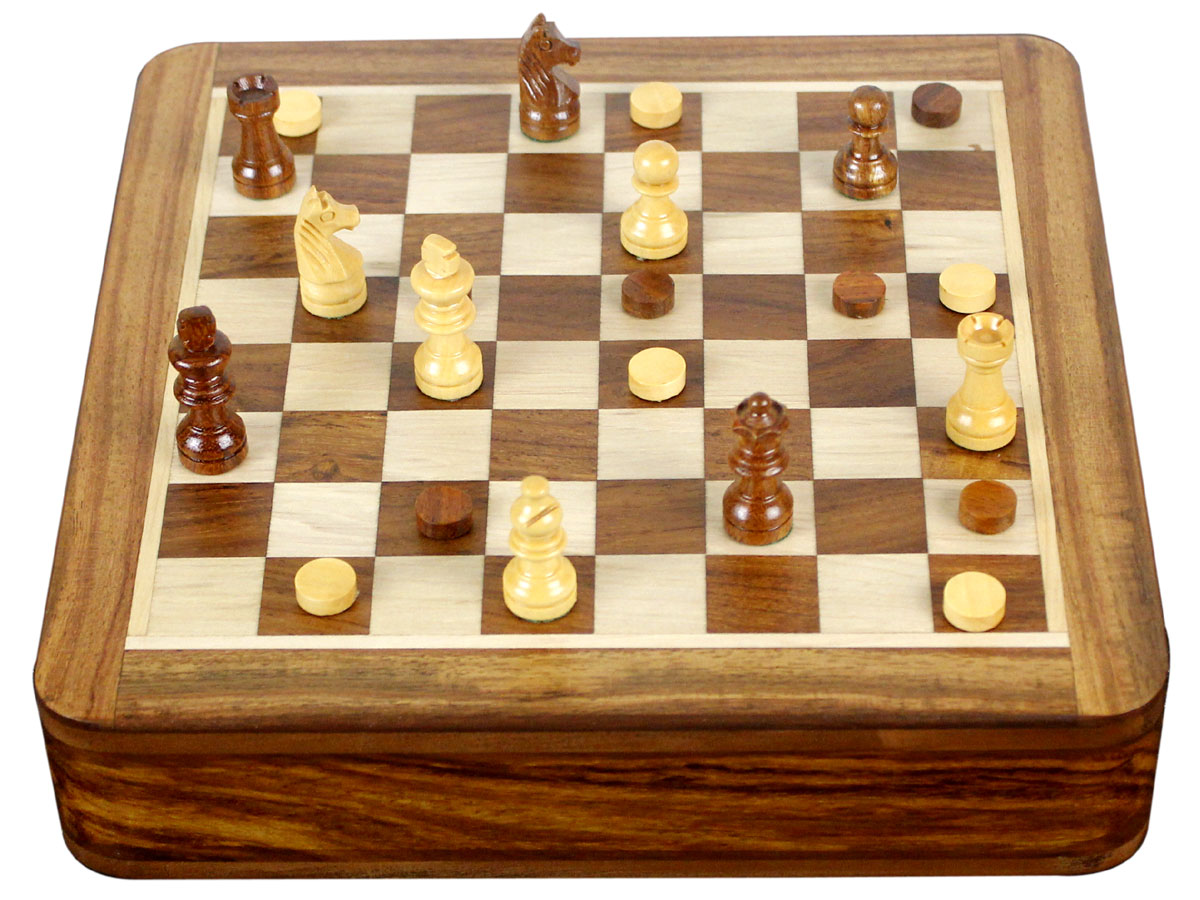 Closed view of chess set combo with checkers and pieces on top
