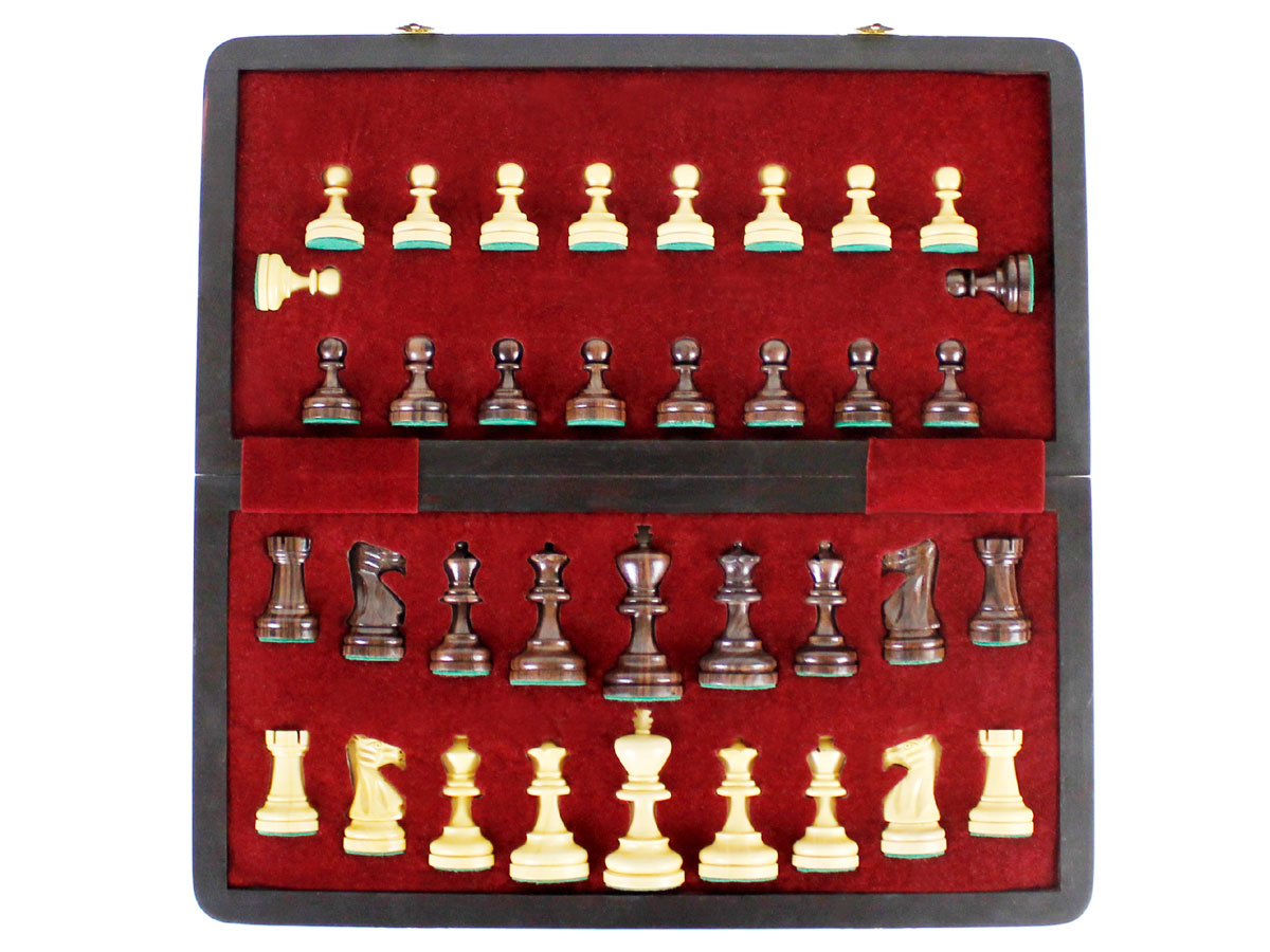 Inner view of chess box and pieces in its place
