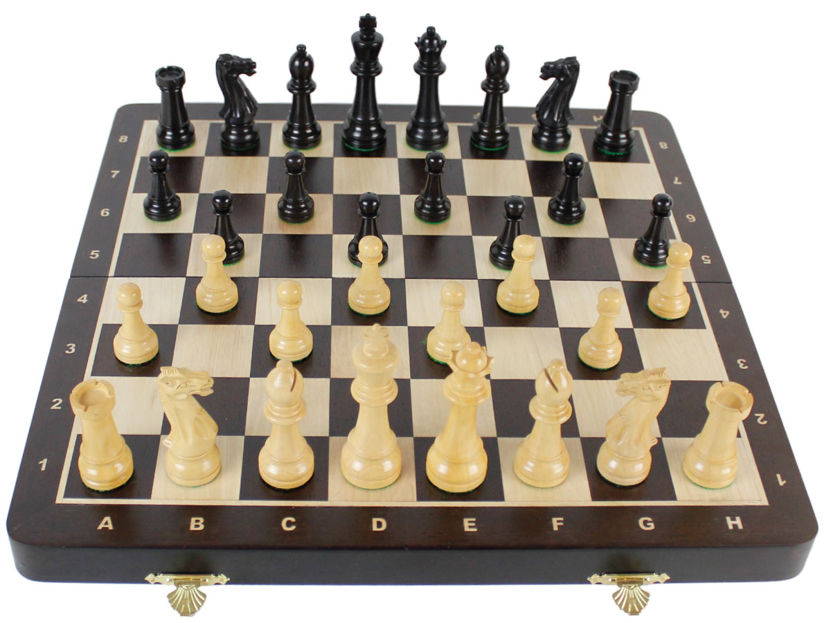 Fully open chess board with laughing knight staunton chess pieces