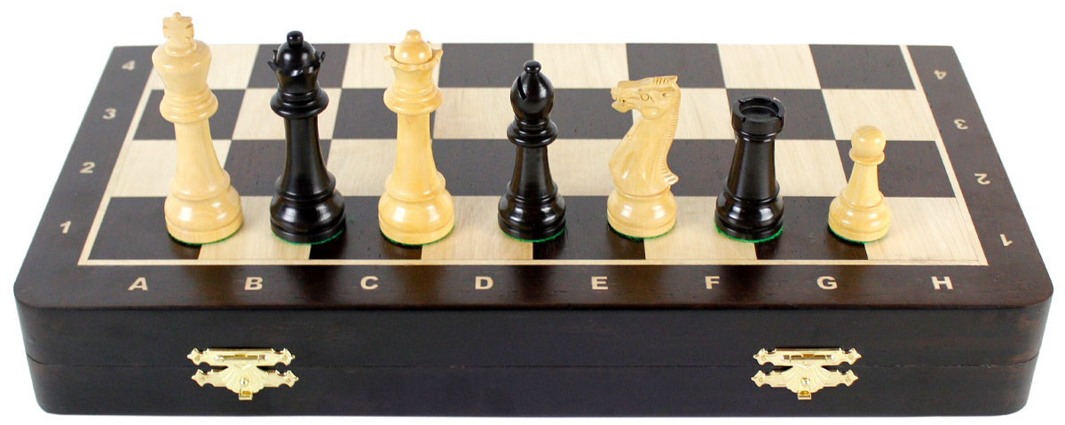 Front view of chess set with pieces on top of board
