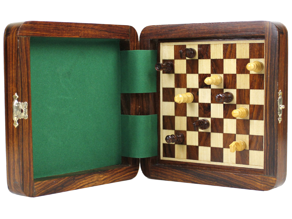 Magnetic Board Inside with Chess Pieces attached held vertically