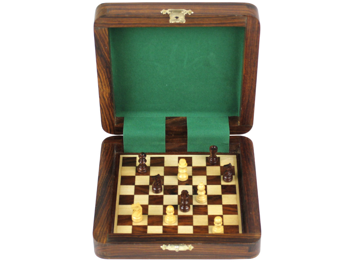 Front view of magnetic chess set board inside with pieces