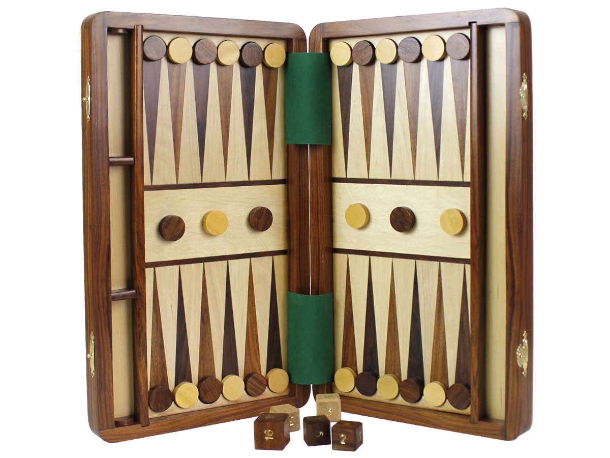 Magnetic Backgammon board held upside down with checkers attached to board
