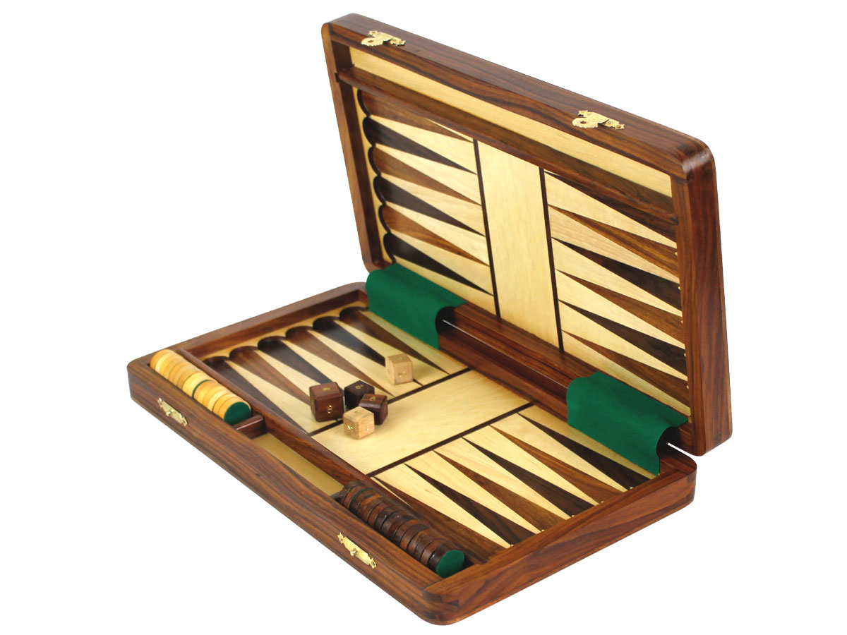 Side view of backgammon with checkers and dice in place