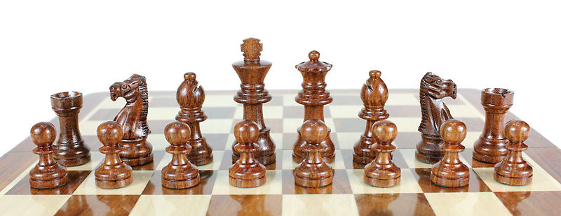 Golden Rosewood Chess Pieces on the Chess board