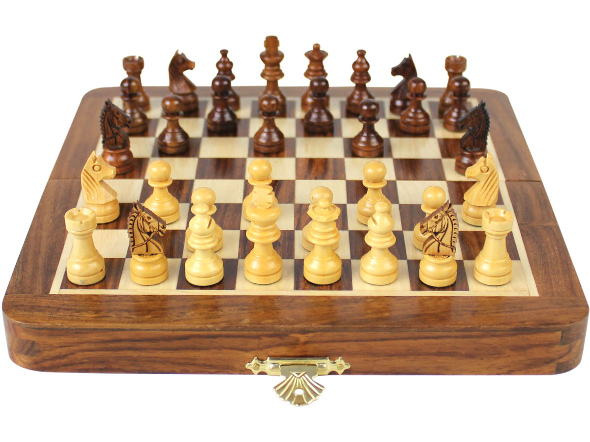 Flat layout of chess board with pieces on top