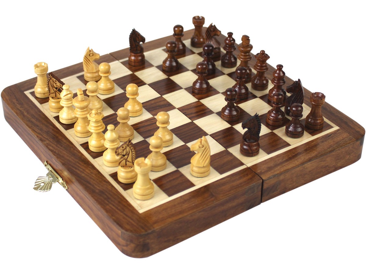 Side view of fully open chess board with pieces on top