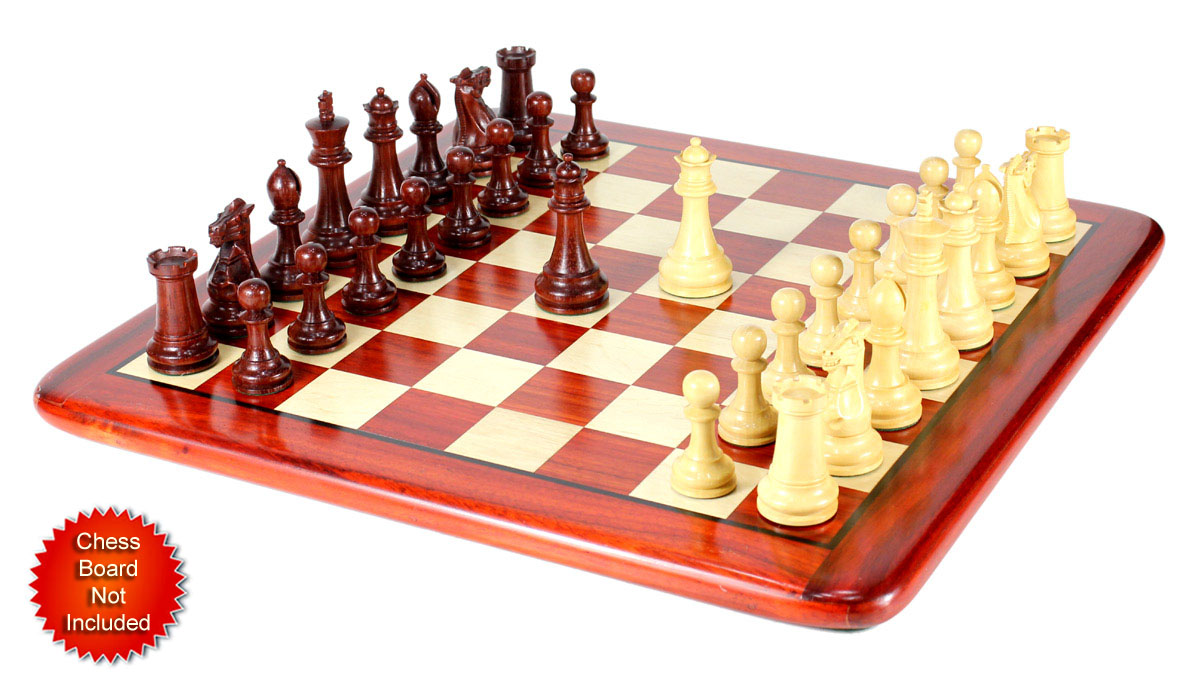 Chess Pieces placed on flat Chess board.