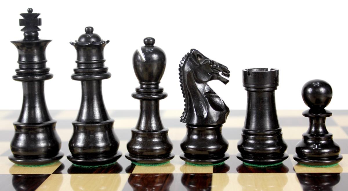 Beautiful Ebony chess pieces with beveled bases.