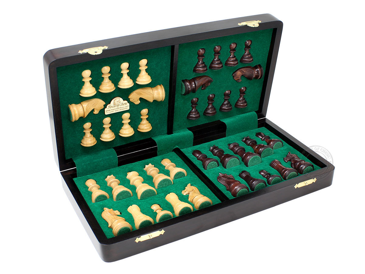 Chess pieces fitted in special inserts made according to the shape of the chess pieces