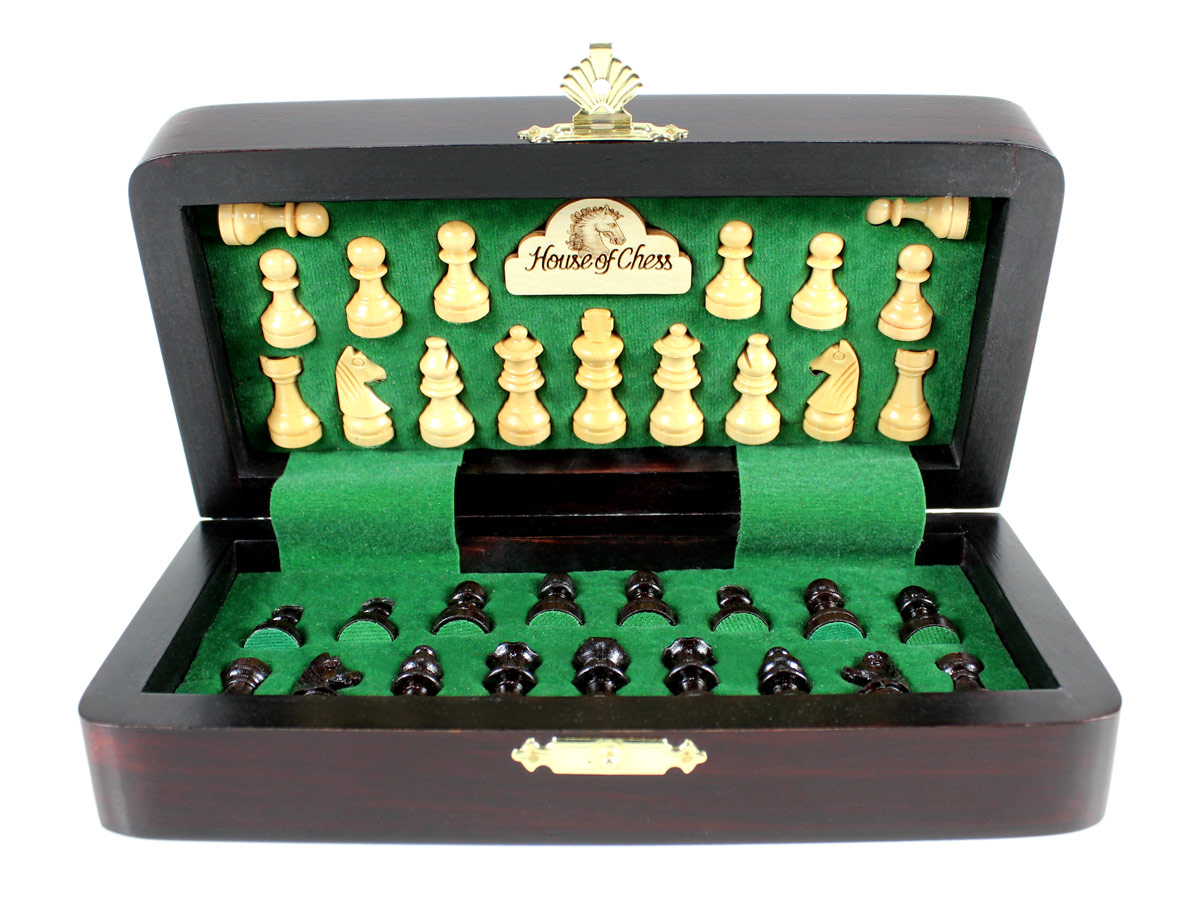 Chess pieces fitted in special inserts made according to the shape of the chess pieces.