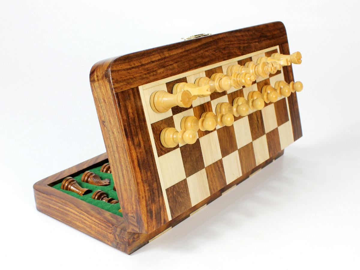 Side view of folding chess set with pieces attached to board