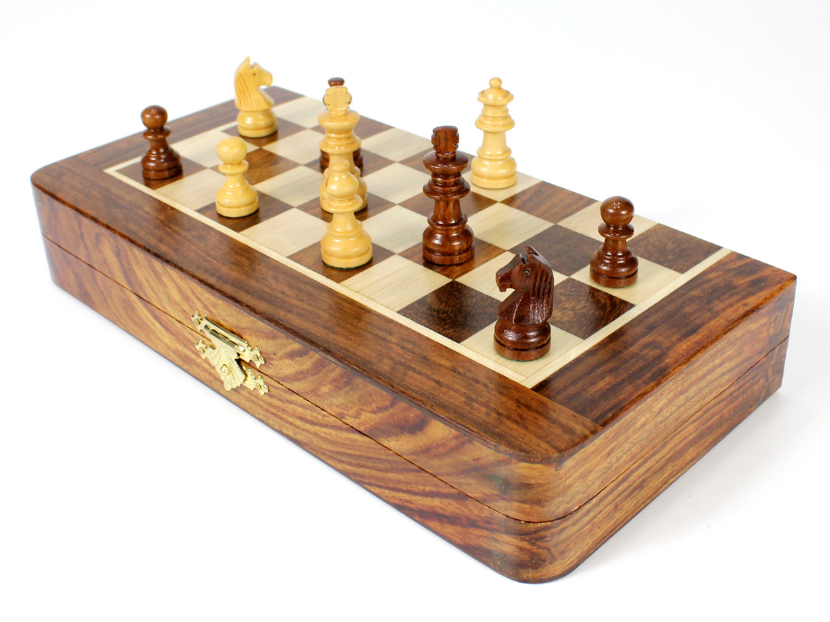Front view of half folded chess board with pieces