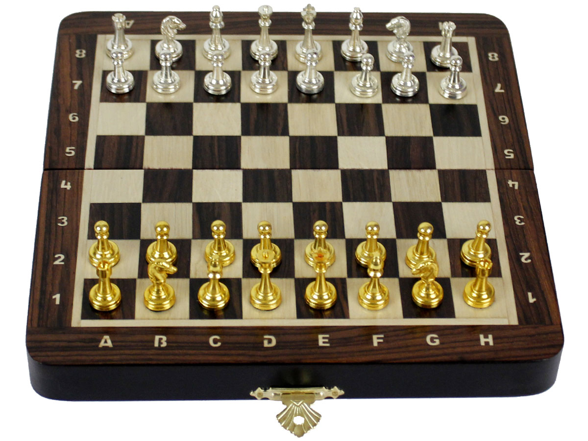 Flat layout of chess board with metal pieces on top