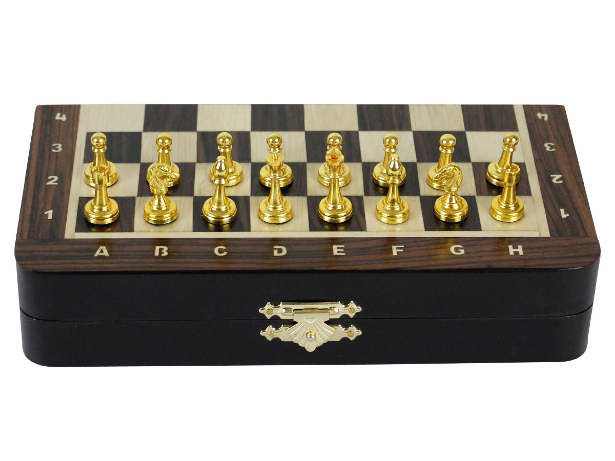 Front view of closed chess board with metal pieces on top