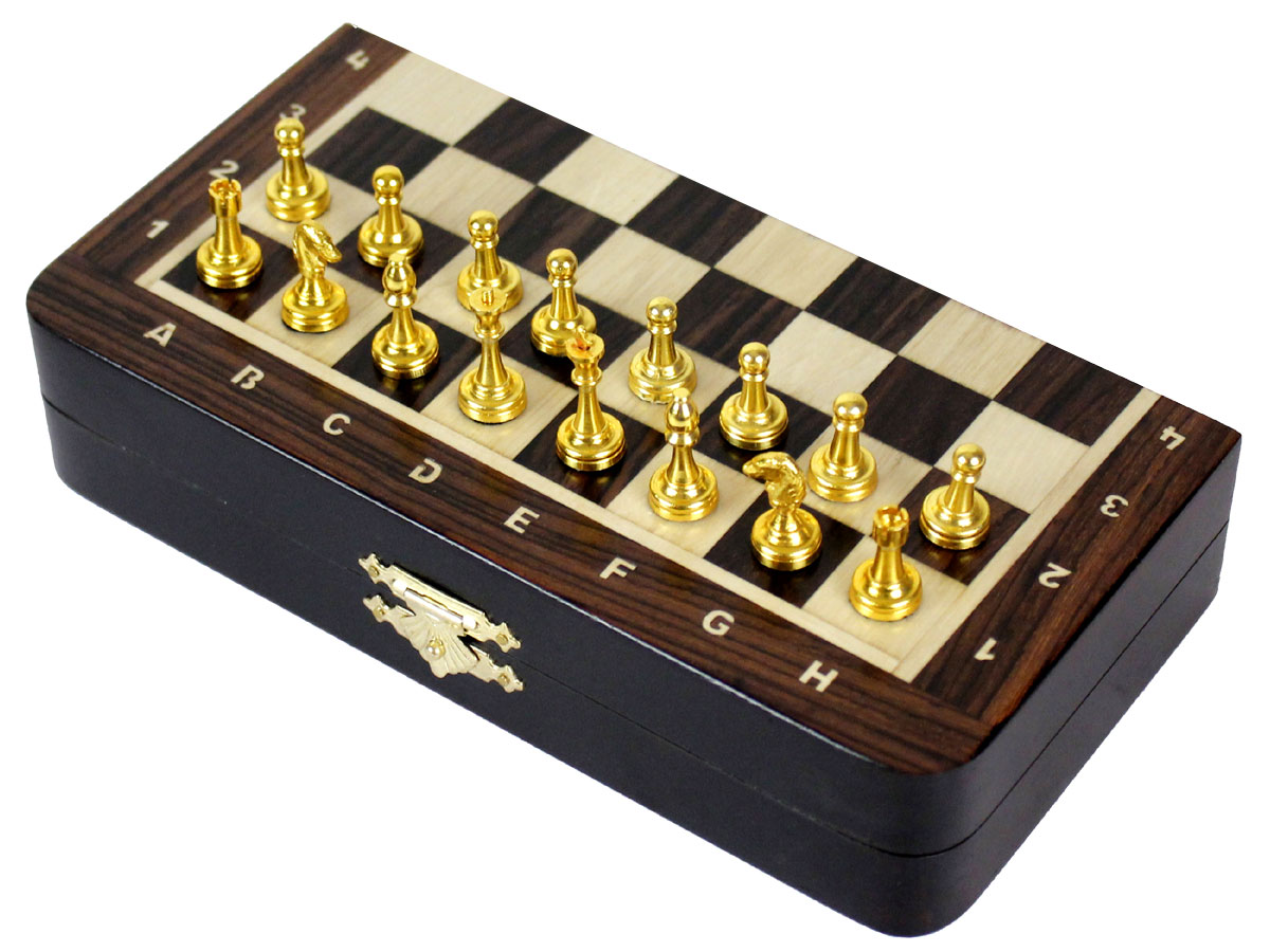 Side view of chess board with metal pieces