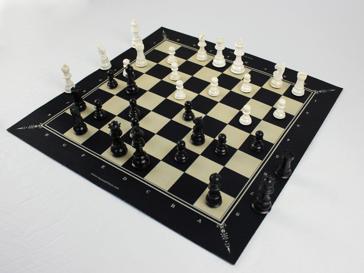 Side view of chess board  with bone pieces