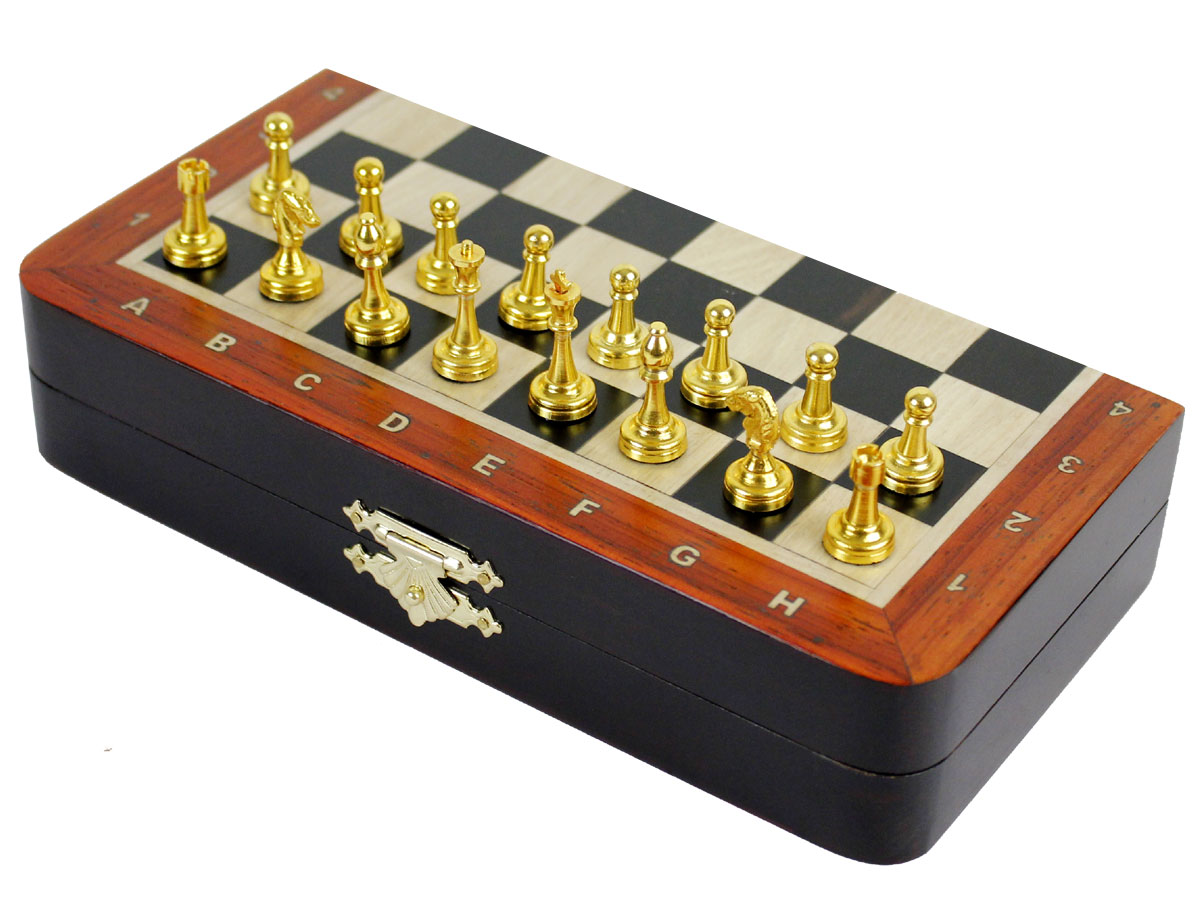 Side view of closed chess board with metal pieces