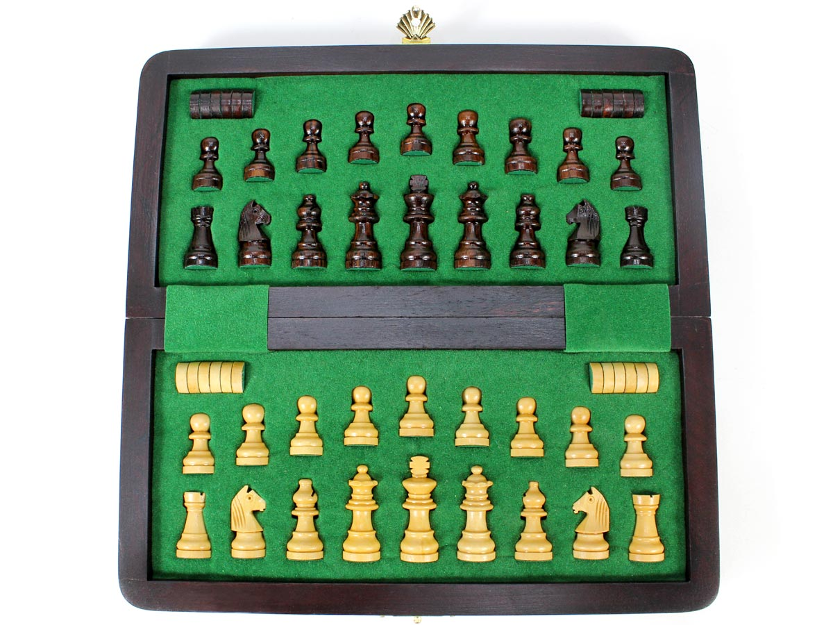 Inner view of chess box with pieces and checkers inserted