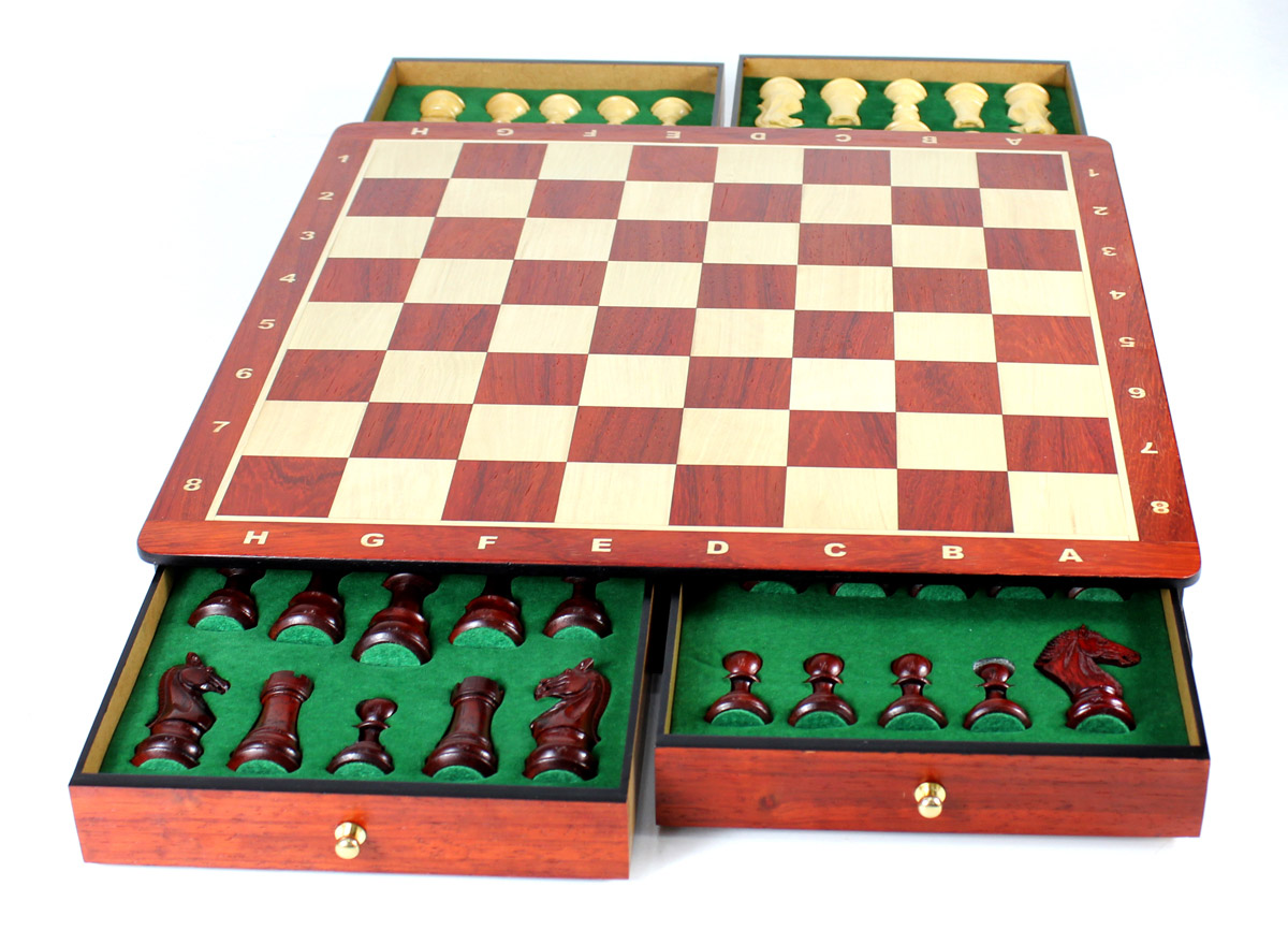 Chess pieces placed in foam cut outs inside the drawers.