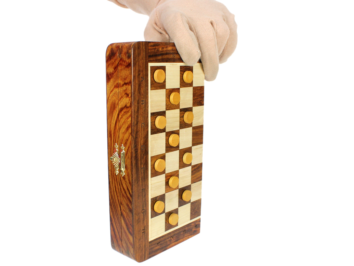 Magnetic Checkers attached to board held vertically