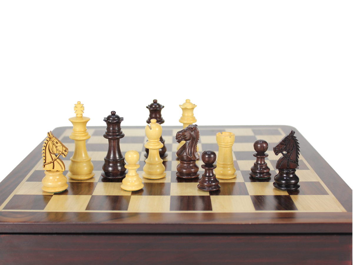 Close up view of chess pieces placed on top of board
