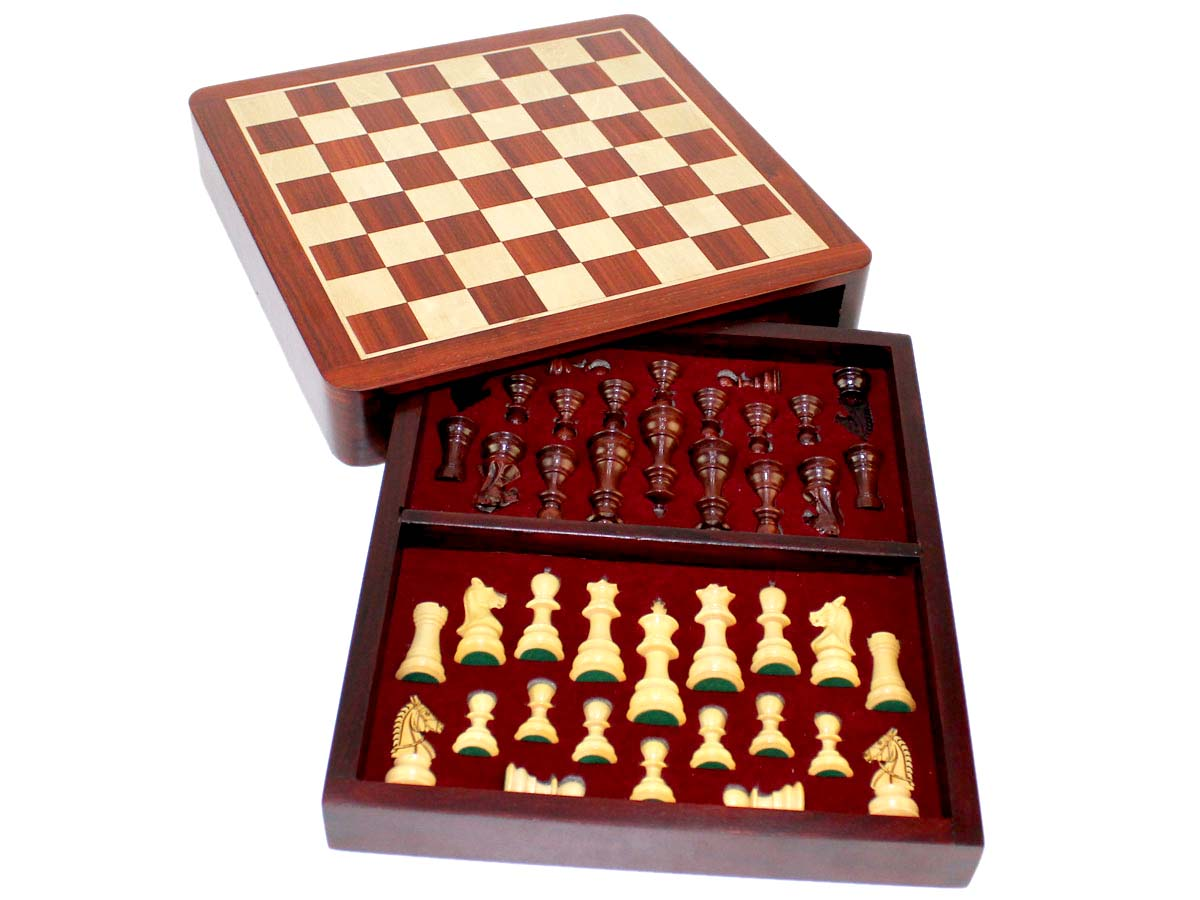 Inner view of chess box with pieces inside tray