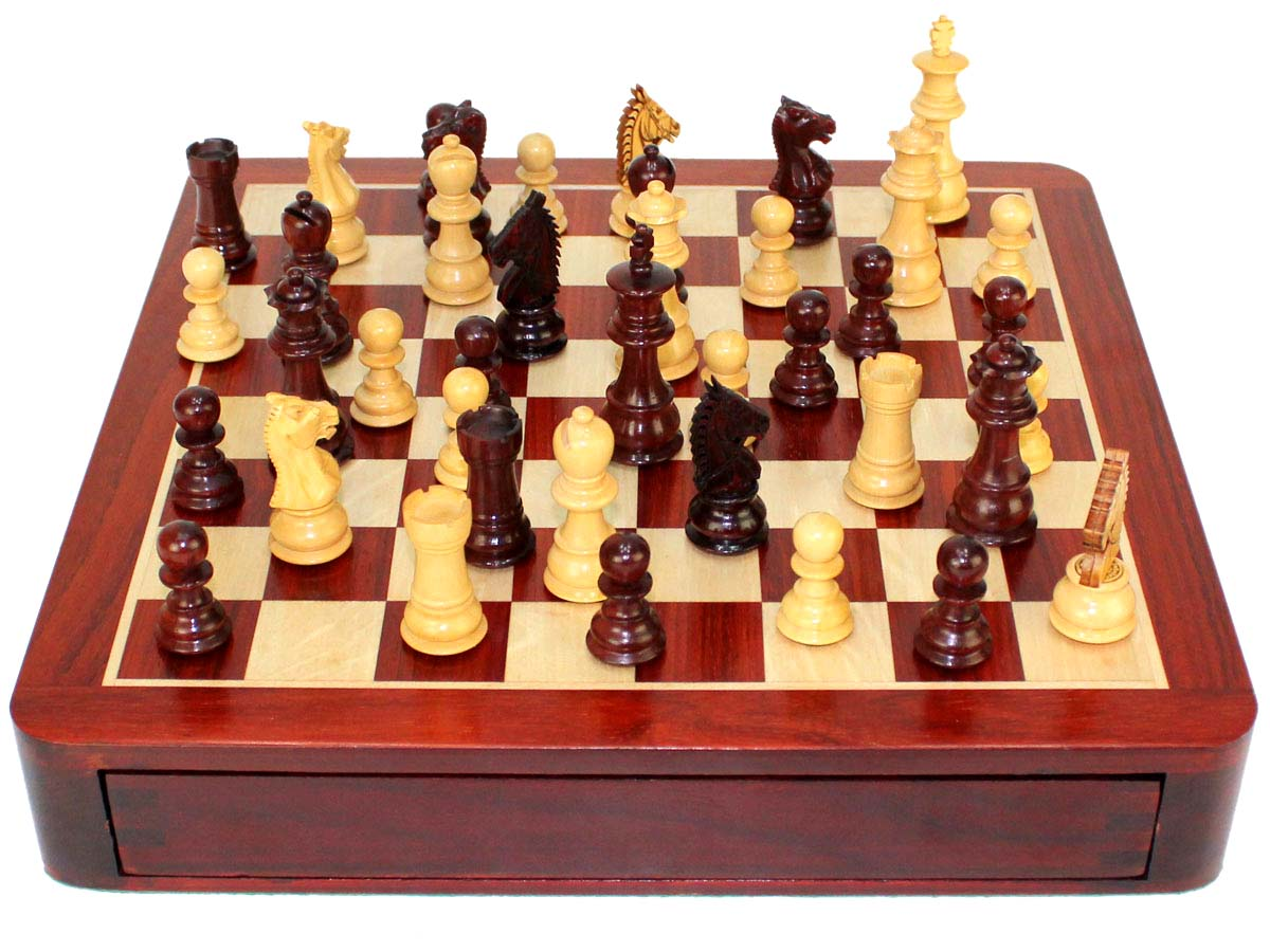 Front view of chess board/box with chess pieces on top