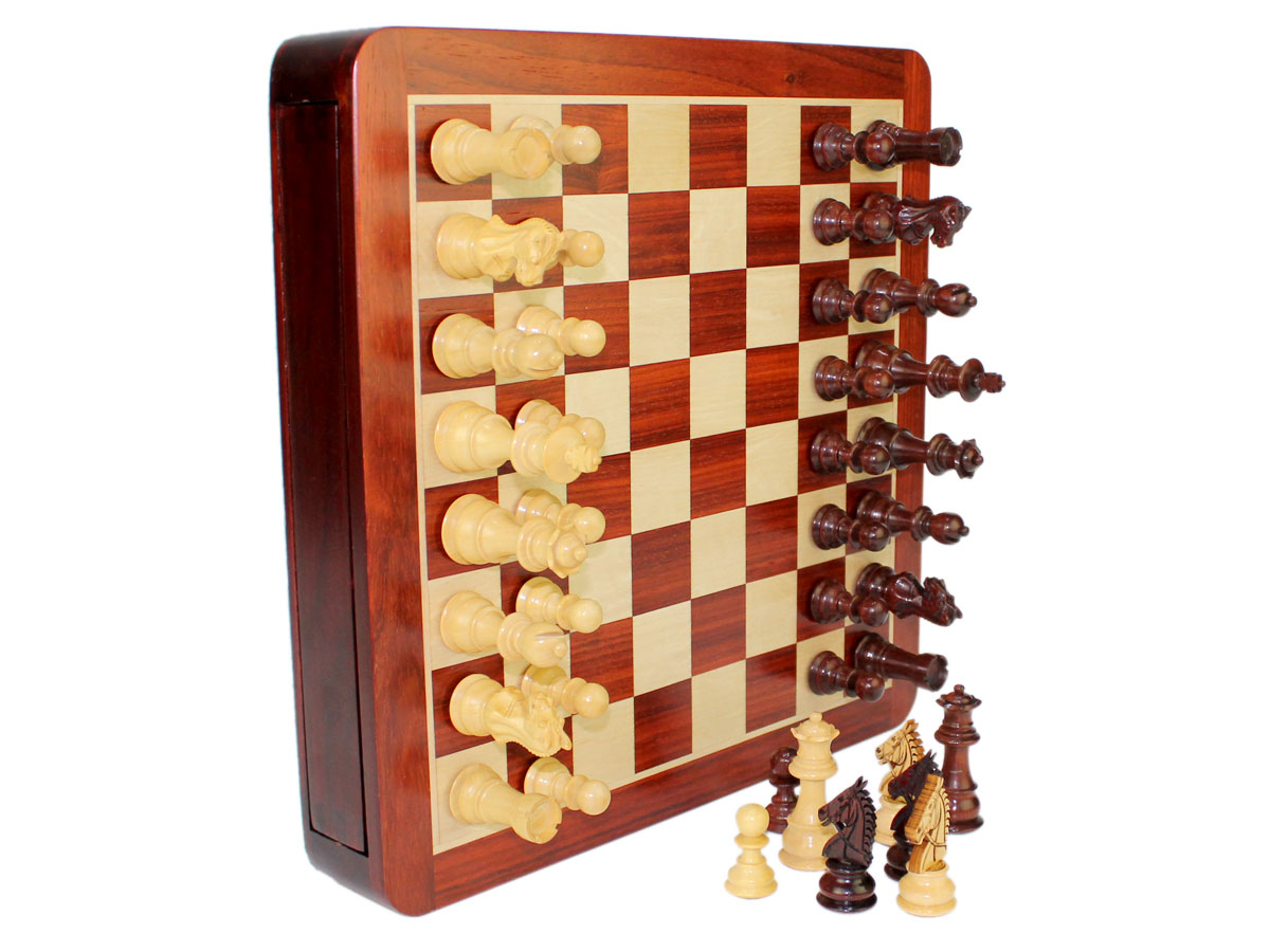 Chess box in vertical position. Magnetic Chess pieces attached to board