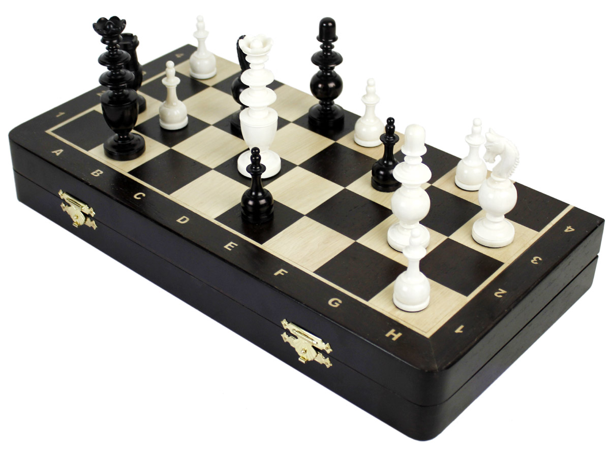 Folding chess board with pieces on top