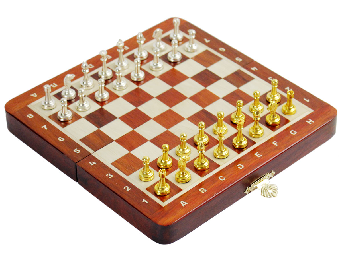 Side view of chess board with metal pieces on top