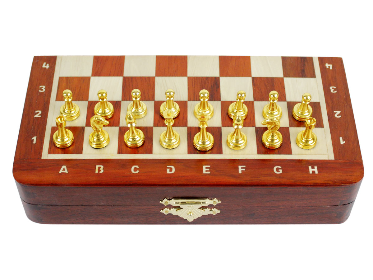 Front view of closed chess board / box with metal pieces